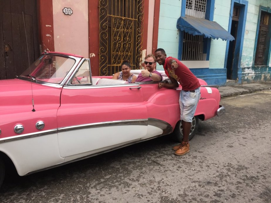 I'm a sucker for a classic car in hot pink! Our guide introduced Drew and I to the local escuela community, and Havana's deep ties to artistic Afro-Cuban expression and Santeria.